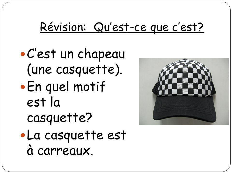 Révision: Quest-ce que cest? Cest un chapeau (une casquette). En quel motif est la casquette? La casquette est à carreaux.