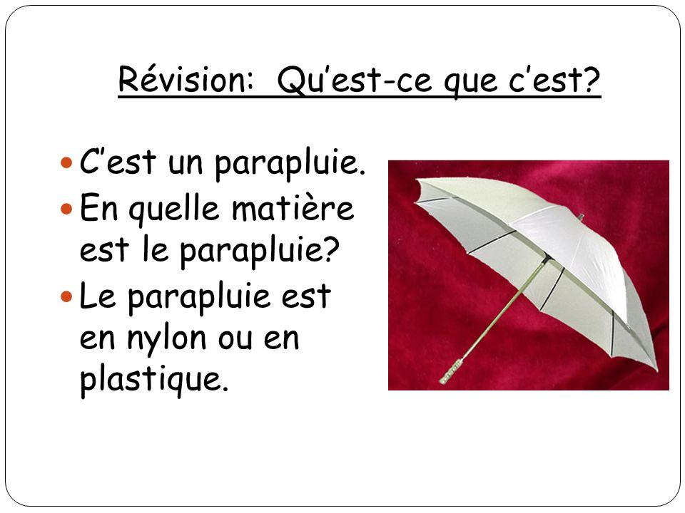 Révision: Quest-ce que cest? Cest un parapluie. En quelle matière est le parapluie? Le parapluie est en nylon ou en plastique.