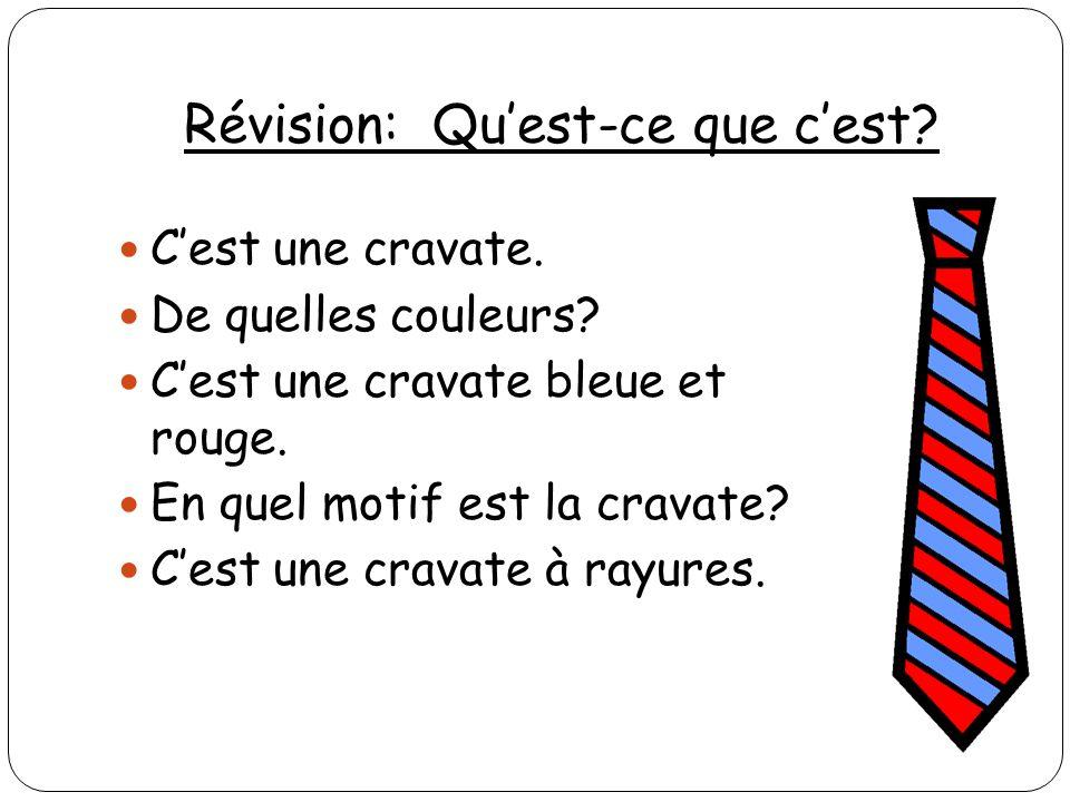 Révision: Quest-ce que cest? Cest une cravate. De quelles couleurs? Cest une cravate bleue et rouge. En quel motif est la cravate? Cest une cravate à