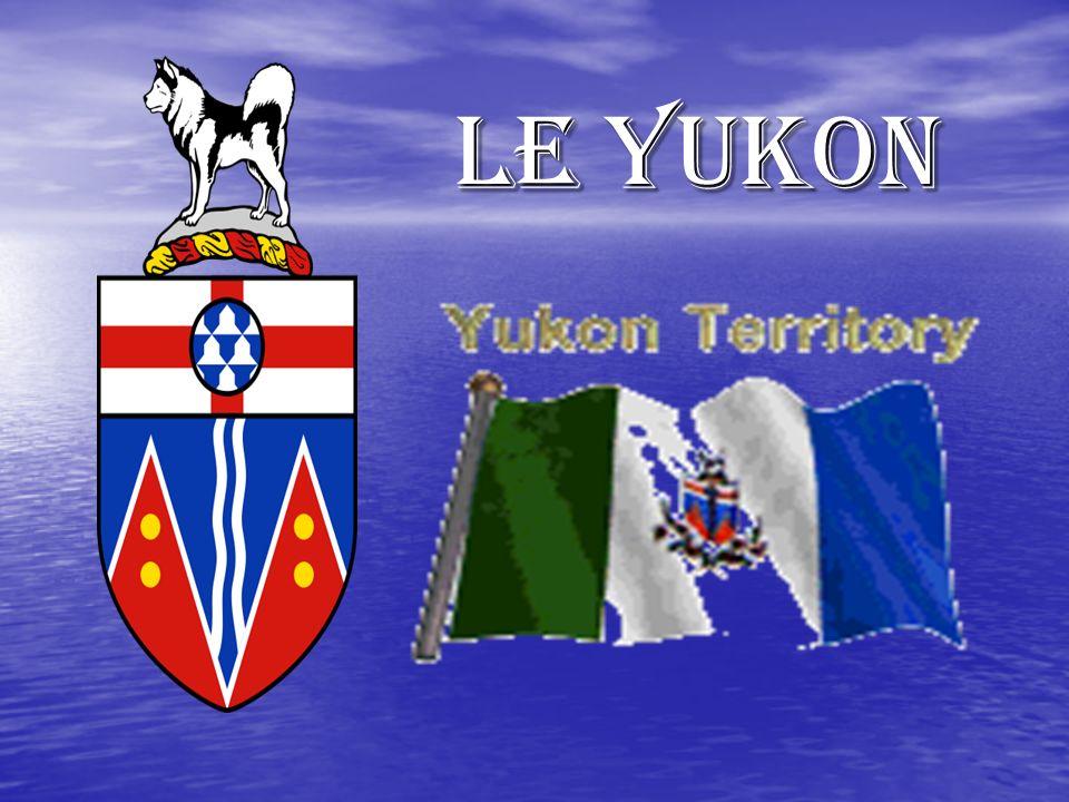 Le drapeau et sa signification (suite) Au centre se trouvent les armoiries du territoire, adopté le 5 Novembre 1956 et entourée de lemblème floral du territoire.