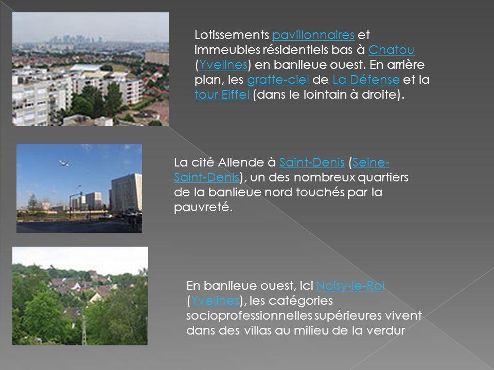 Lotissements pavillonnaires et immeubles résidentiels bas à Chatou (Yvelines) en banlieue ouest. En arrière plan, les gratte-ciel de La Défense et la
