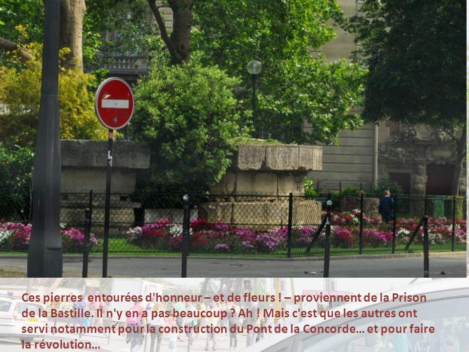 Ces pierres entourées d honneur – et de fleurs .– proviennent de la Prison de la Bastille.