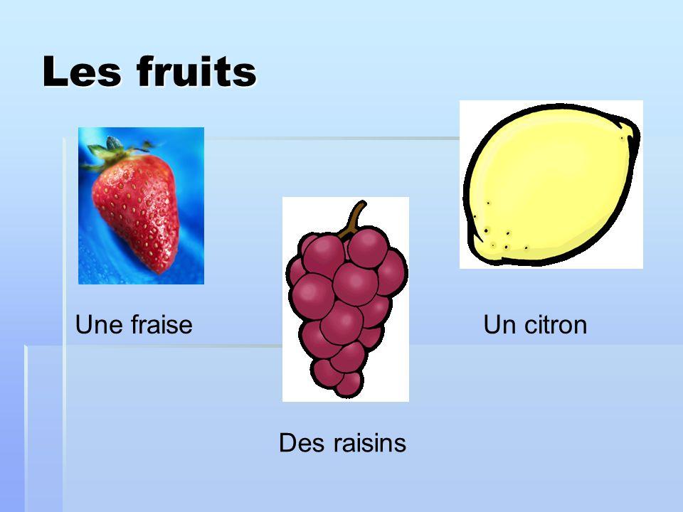 Les fruits Une fraise Des raisins Un citron