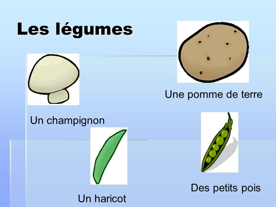 Les légumes Un champignon Une pomme de terre Des petits pois Un haricot