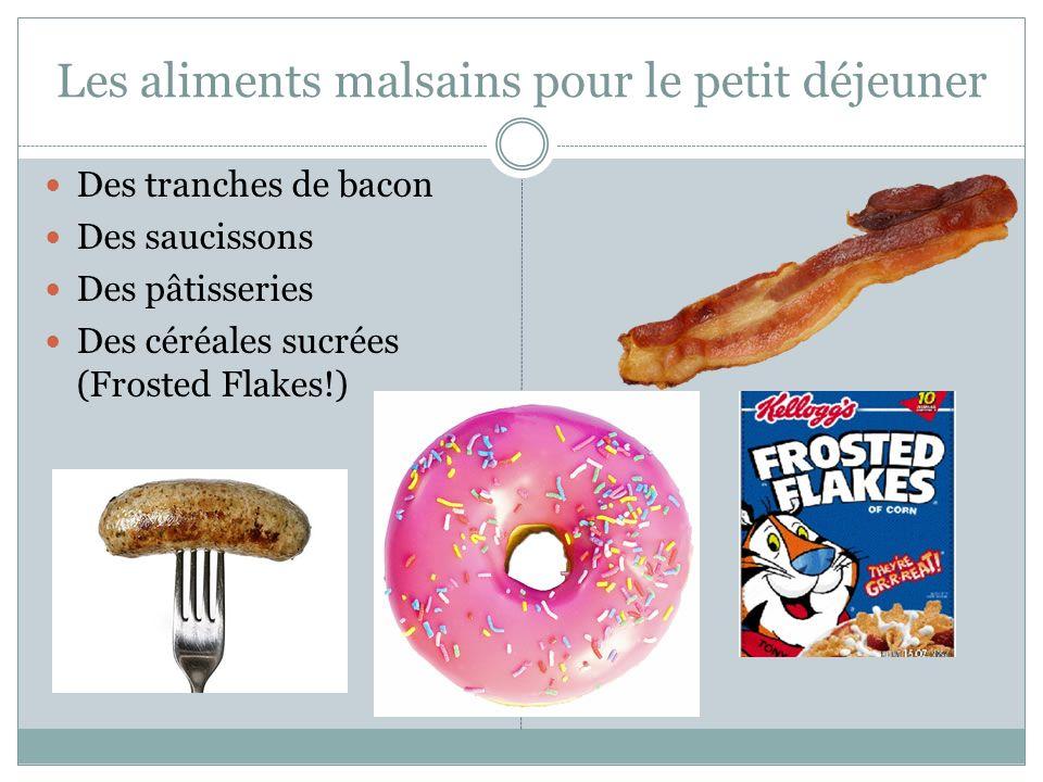 Les aliments malsains pour le petit déjeuner Des tranches de bacon Des saucissons Des pâtisseries Des céréales sucrées (Frosted Flakes!)