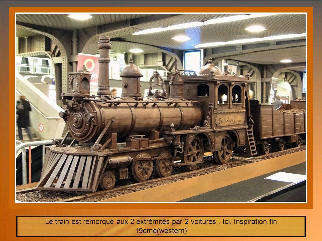 Semaine du Chocolat Belge 19-25 Novembre 2012 En ce jour du 19 Novembre, un train pour le moins insolite, arrive en gare de Midi- Bruxelles Le Train en chocolat Une œuvre du Maître Chocolatier Andrew Farrugia ------------------- Longueur : 34,05m Chocolat : 1250kg (chocolat Belge) Travail : entre 700 et 800h Poids : 1 Tonne (informations officielles seront dans le Guinness Book