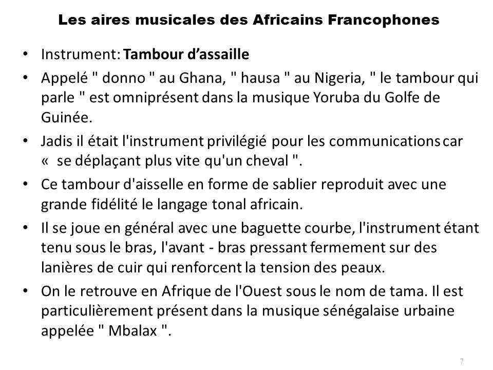Les aires musicales des Africains Francophones 8 Instrument: Balafon (a droite), La Kora (a gauche)