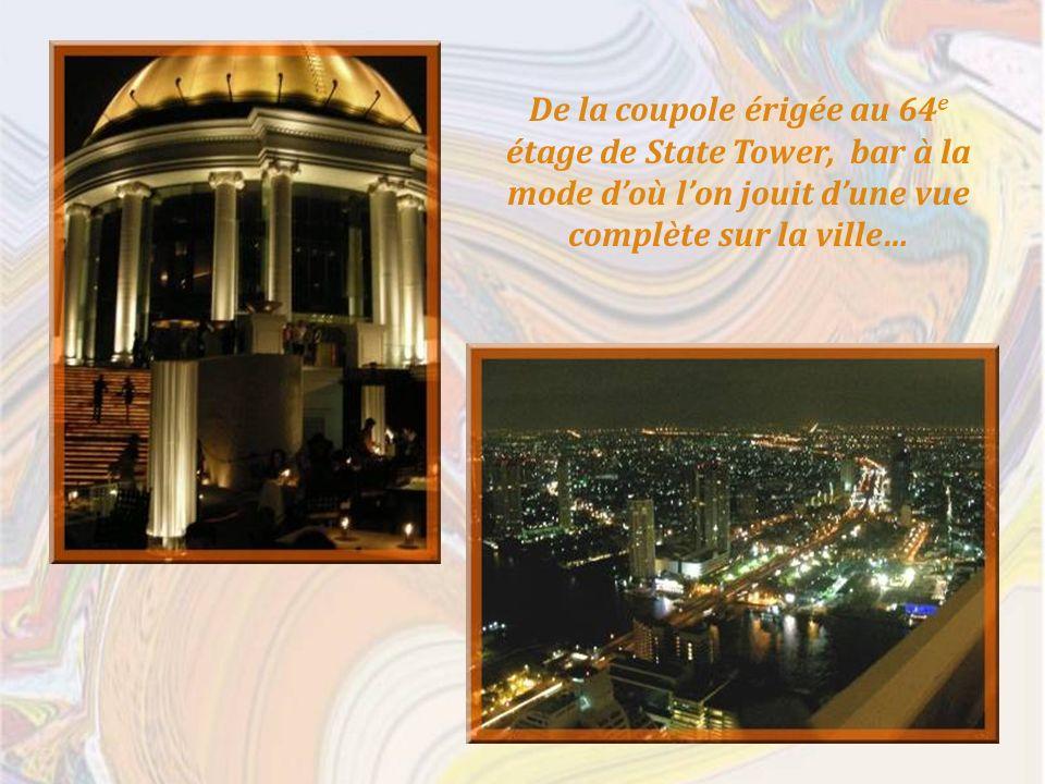 De la coupole érigée au 64 e étage de State Tower, bar à la mode doù lon jouit dune vue complète sur la ville…