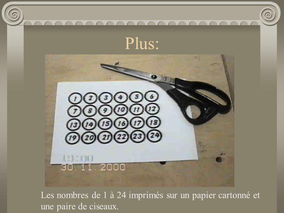 Plus: Les nombres de 1 à 24 imprimés sur un papier cartonné et une paire de ciseaux.