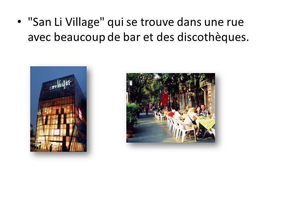 San Li Village qui se trouve dans une rue avec beaucoup de bar et des discothèques.