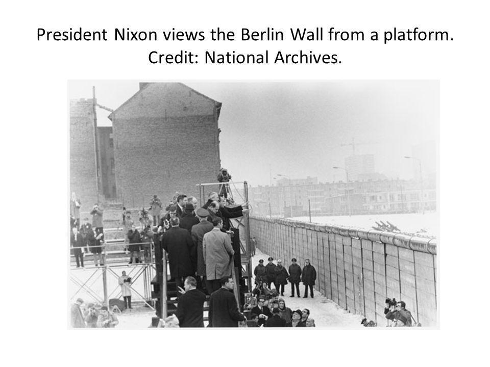President Nixon views the Berlin Wall from a platform. Credit: National Archives.