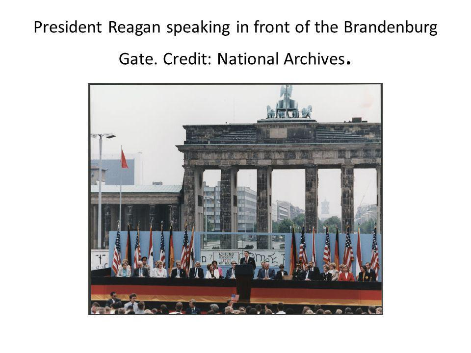 President Reagan speaking in front of the Brandenburg Gate. Credit: National Archives.