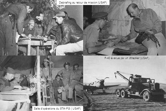 Debriefing au retour de mission (USAF) Salle dopérations du 87th FG ( USAF) P-40 évacué par un Wrecker (USAF)