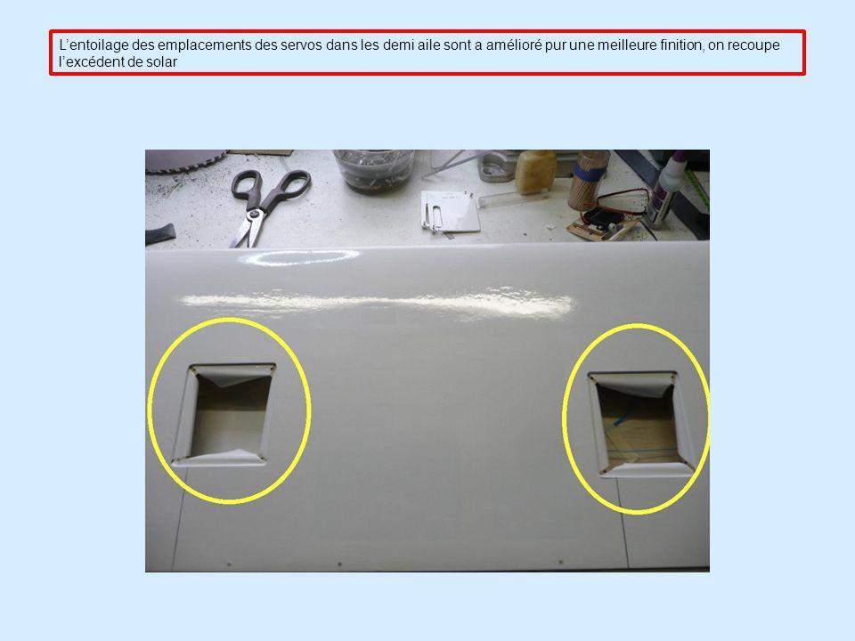 Lentoilage des emplacements des servos dans les demi aile sont a amélioré pur une meilleure finition, on recoupe lexcédent de solar