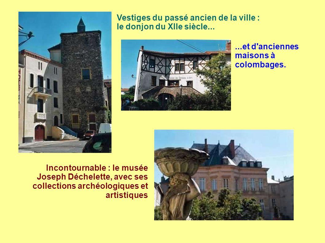 Vestiges du passé ancien de la ville : le donjon du XIIe siècle......et d anciennes maisons à colombages.