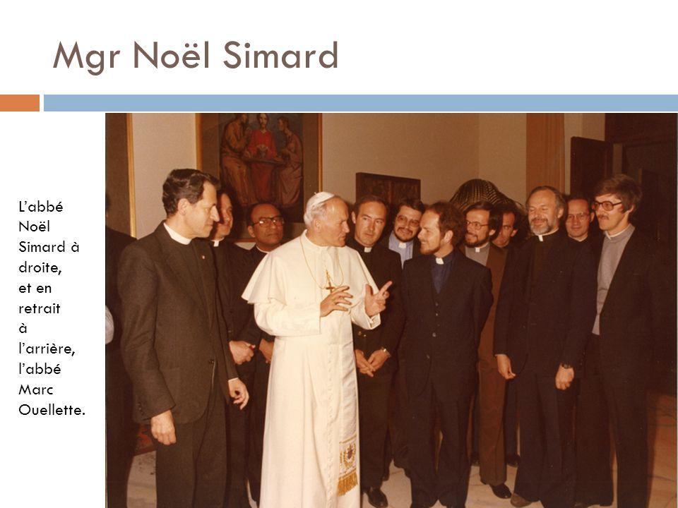 Mgr Noël Simard Labbé Noël Simard à droite, et en retrait à larrière, labbé Marc Ouellette.