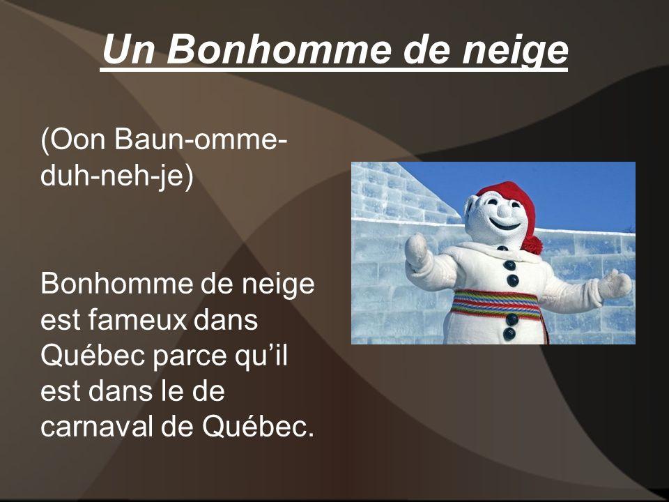 Un Bonhomme de neige (Oon Baun-omme- duh-neh-je) Bonhomme de neige est fameux dans Québec parce quil est dans le de carnaval de Québec.