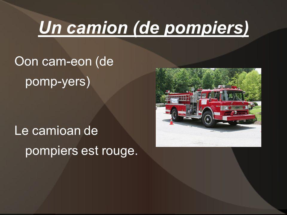 Un camion (de pompiers) Oon cam-eon (de pomp-yers) Le camioan de pompiers est rouge.