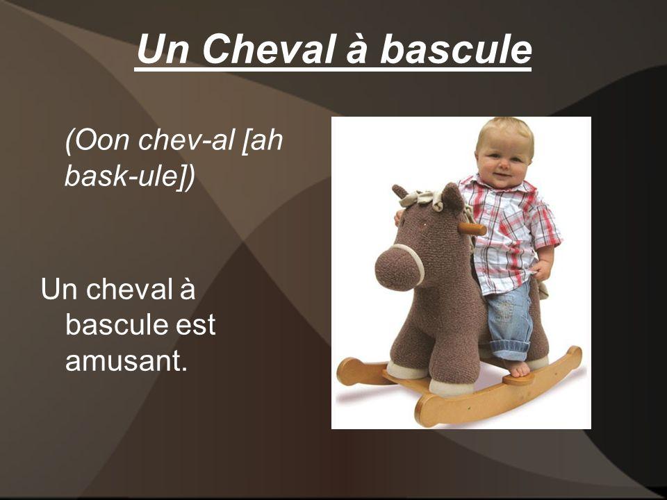 Un Cheval à bascule Un cheval à bascule est amusant. (Oon chev-al [ah bask-ule])