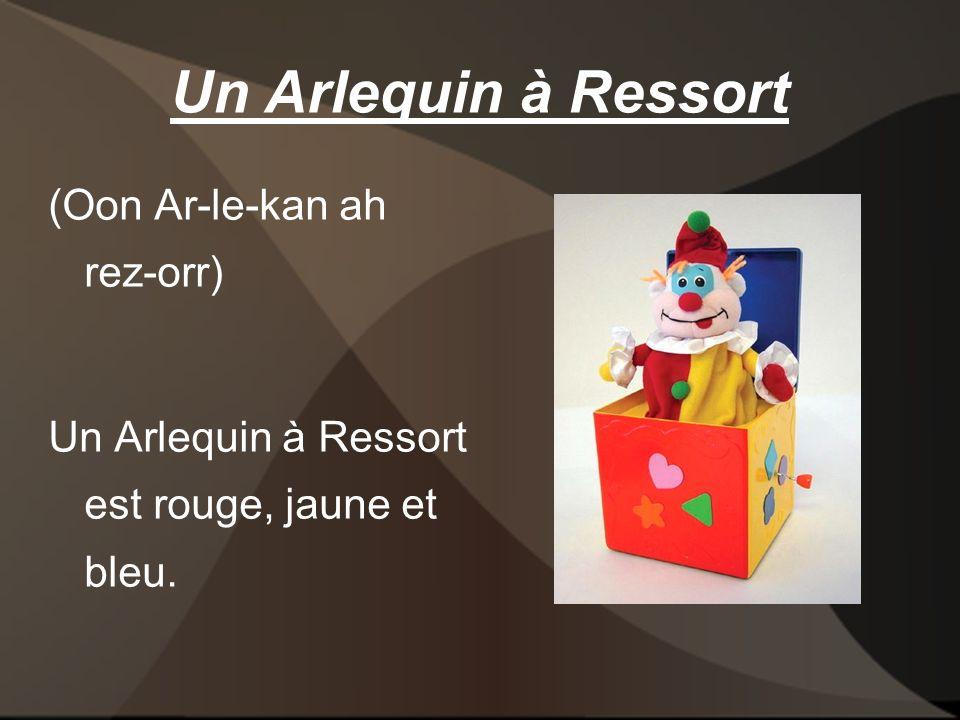 Un Arlequin à Ressort (Oon Ar-le-kan ah rez-orr) Un Arlequin à Ressort est rouge, jaune et bleu.