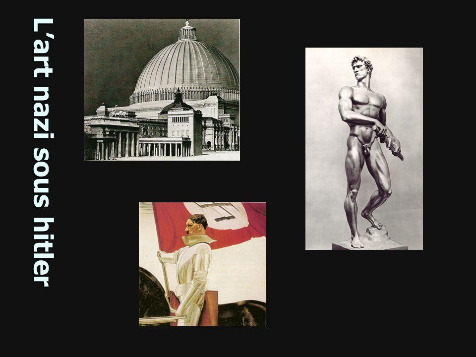 Prêt au combat, (Bereitschaft) Arno Breker Sculpture de 1939, Zeppelinfeld, Nuremberg 1- Décrivez les caractéristiques physiques et lattitude (regard, posture..) de lhomme sculpté.