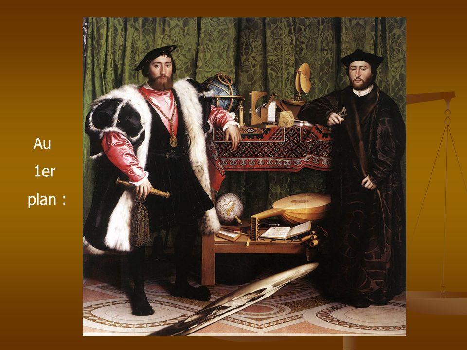 Les deux personnages À gauche, Jean de Dinteville, ambassadeur dit de « robe courte », détenteur du pouvoir politique.