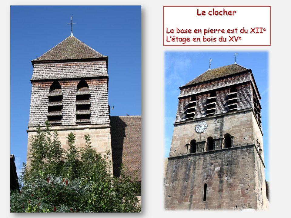 Le clocher La base en pierre est du XII e Létage en bois du XV e