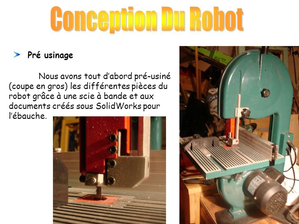 Nous avons tout dabord pré-usiné (coupe en gros) les différentes pièces du robot grâce à une scie à bande et aux documents créés sous SolidWorks pour lébauche.