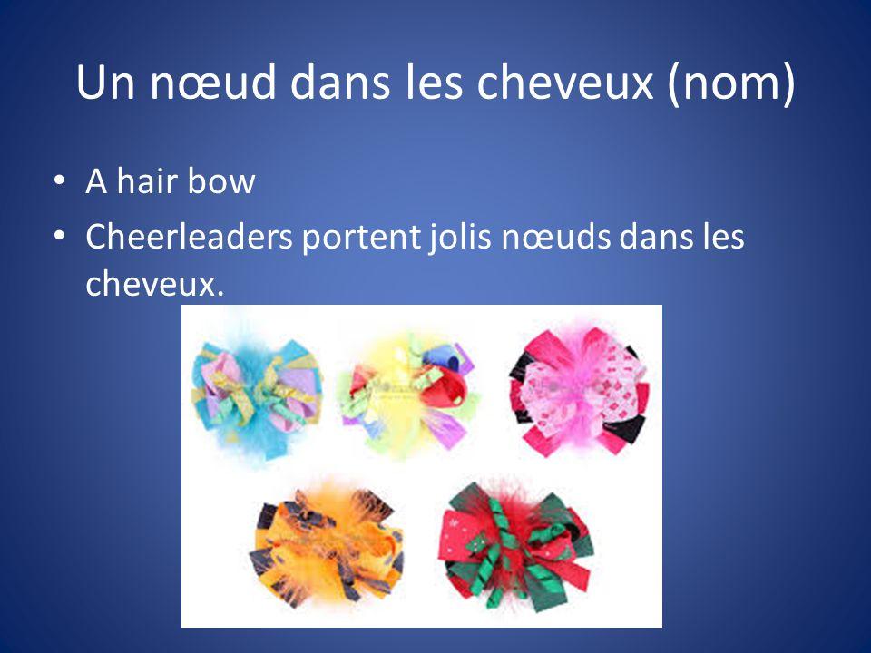 Un nœud dans les cheveux (nom) A hair bow Cheerleaders portent jolis nœuds dans les cheveux.