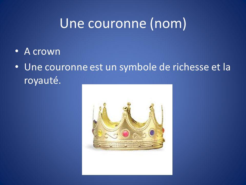 Une couronne (nom) A crown Une couronne est un symbole de richesse et la royauté.