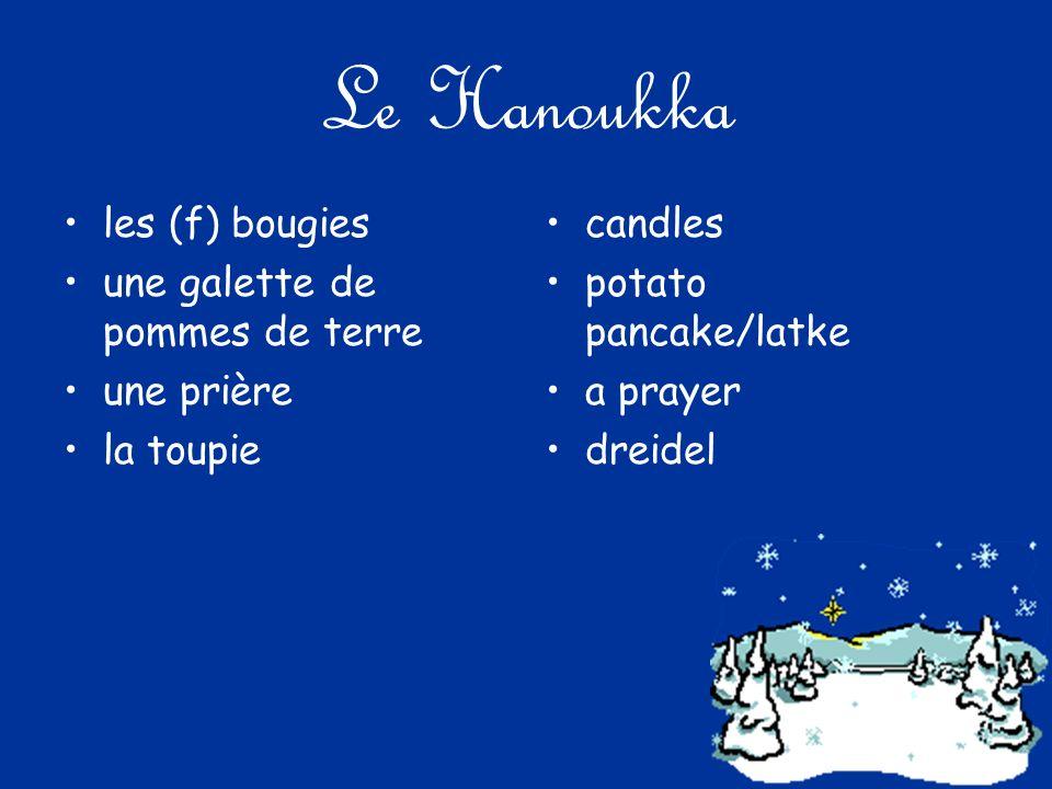 Le Hanoukka les (f) bougies une galette de pommes de terre une prière la toupie candles potato pancake/latke a prayer dreidel