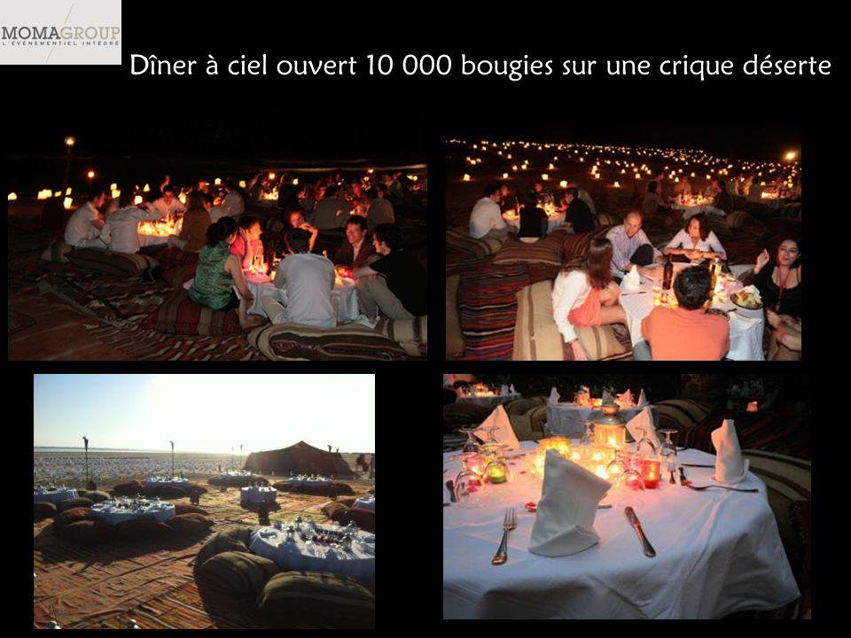 Dîner à ciel ouvert 10 000 bougies sur une crique déserte