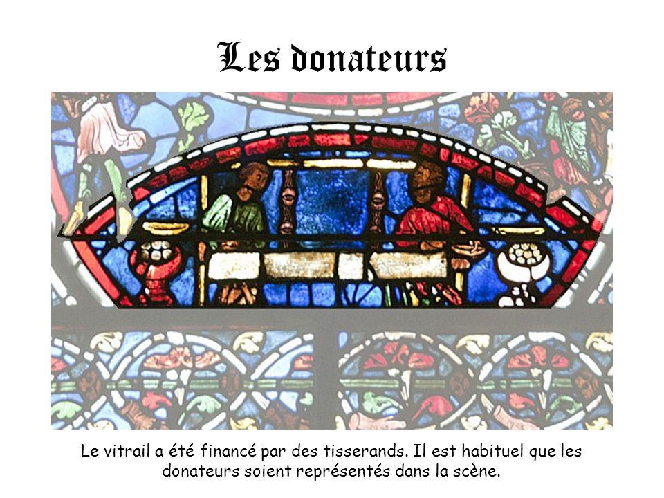 Les donateurs Le vitrail a été financé par des tisserands. Il est habituel que les donateurs soient représentés dans la scène.
