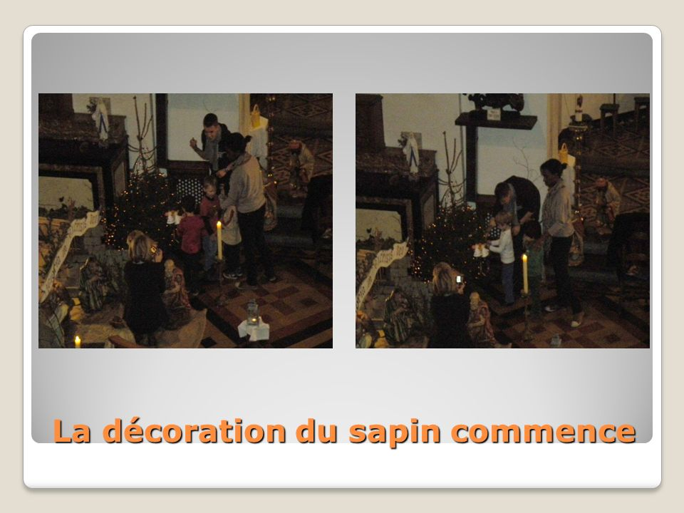 Les enfants vont accrocher au sapin leurs décorations réalisées à lécole