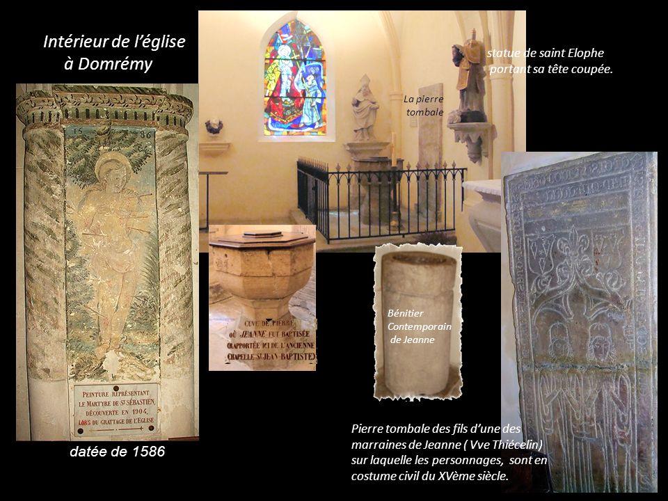Retable, XVIème, don de Claude du Lys, curé de Domremy et arrière petit neveu de Jeanne, avec une vierge de la même époque Retable du XVII Statue en bois 74cm avec sous la couche grise des traces de dorure et polychromie.