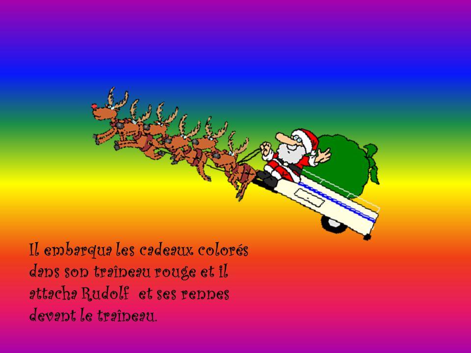 Il embarqua les cadeaux colorés dans son traîneau rouge et il attacha Rudolf et ses rennes devant le traîneau.