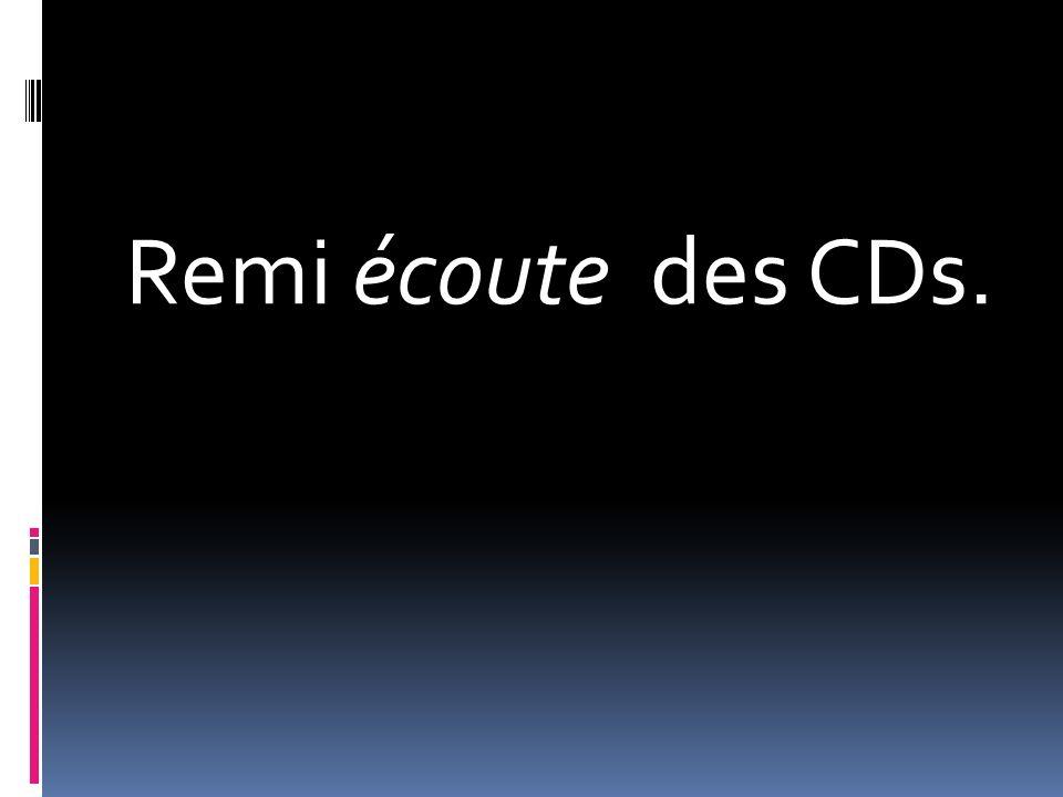 Remi écoute des CDs.