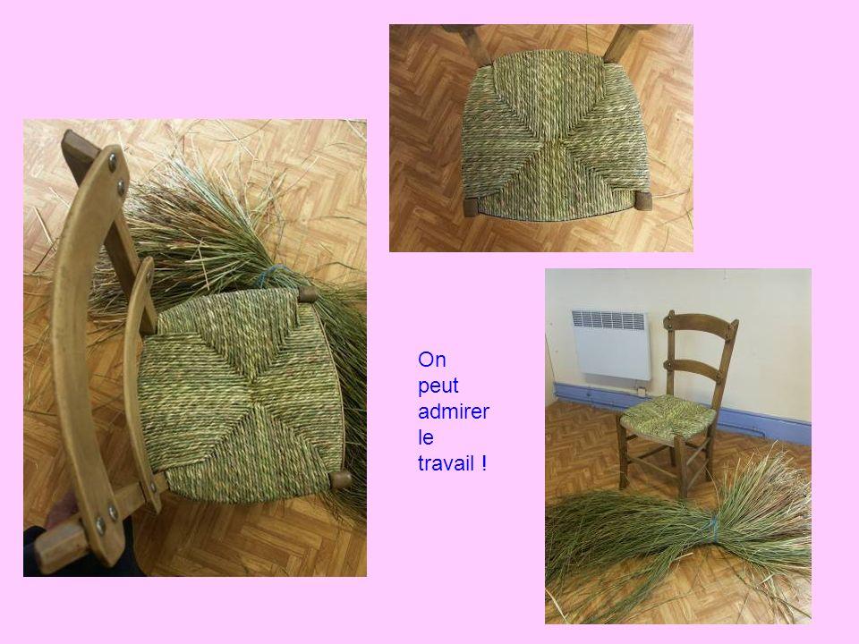 Patrick « notre maître » soccupe de la finition: cest la pose de la baguette de protection à lavant de la chaise.