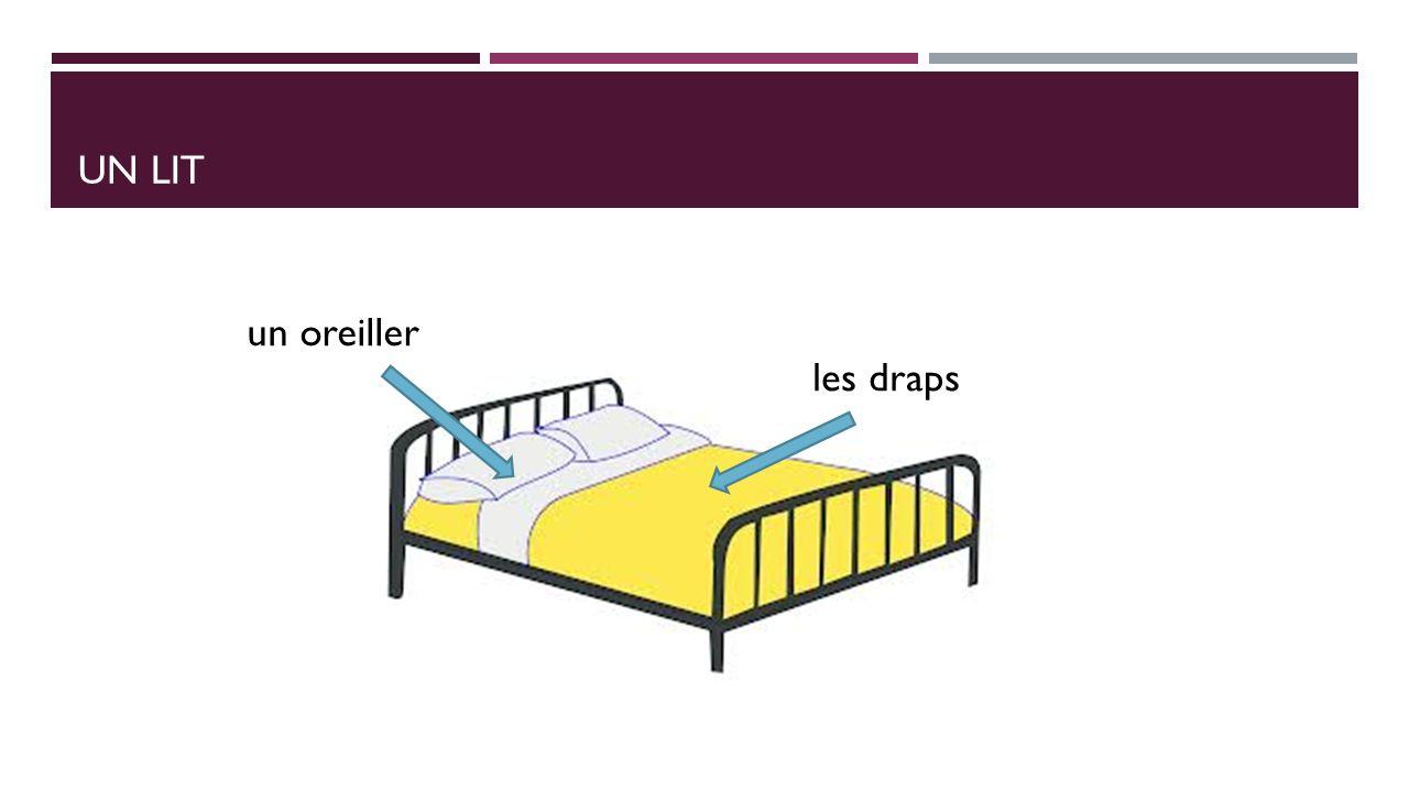 UN LIT les draps un oreiller