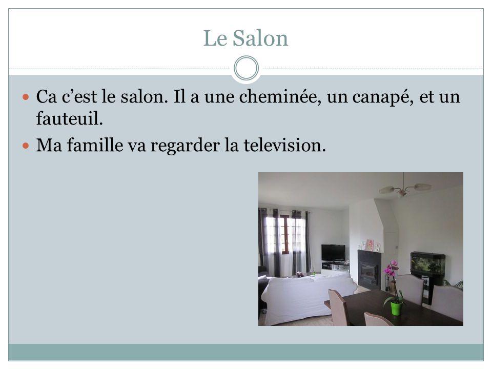 Le Salon Ca cest le salon. Il a une cheminée, un canapé, et un fauteuil. Ma famille va regarder la television.