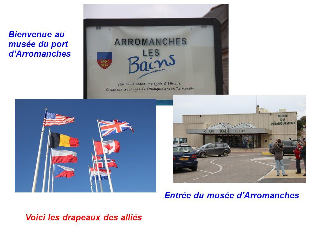 Bienvenue au musée du port d'Arromanches Voici les drapeaux des alliés Entrée du musée d'Arromanches