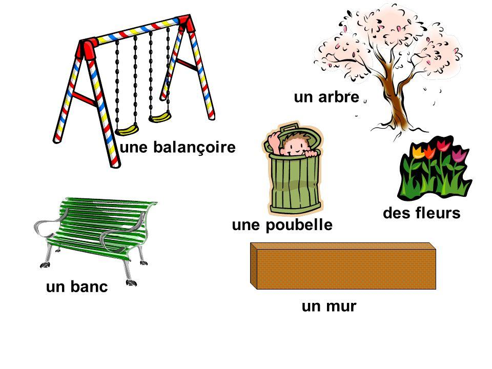 une balançoire un banc une poubelle des fleurs un arbre un mur