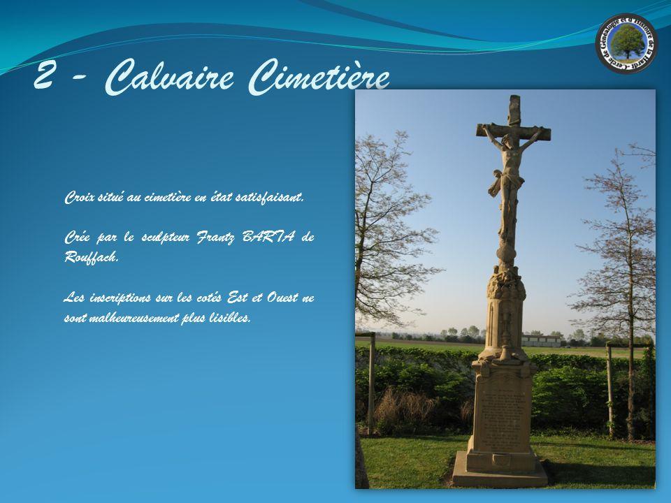 2 - Calvaire Cimetière Croix situé au cimetière en état satisfaisant.