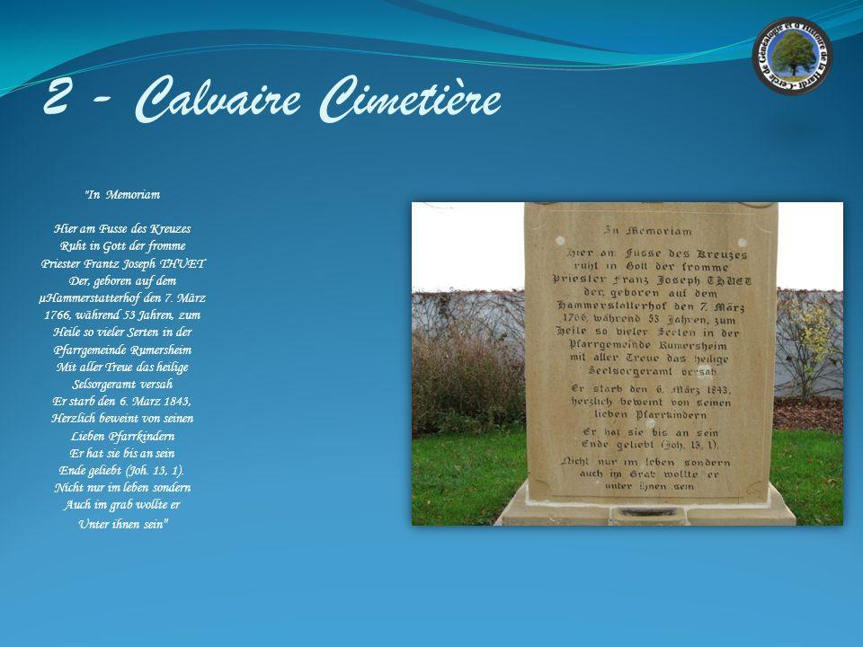 2 - Calvaire Cimetière Croix situé au cimetière en état satisfaisant. Crée par le sculpteur Frantz BARTA de Rouffach. Les inscriptions sur les cotés E