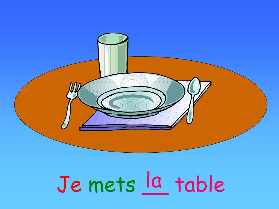 Je mets __ table la
