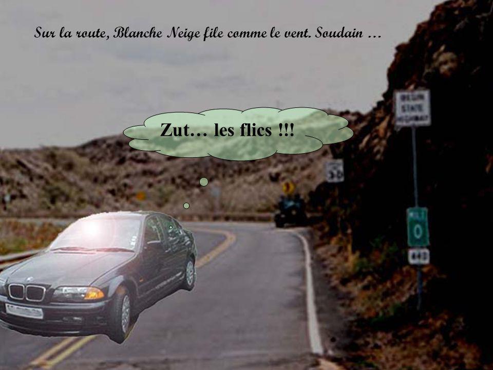 Zut… les flics !!! Sur la route, Blanche Neige file comme le vent. Soudain …