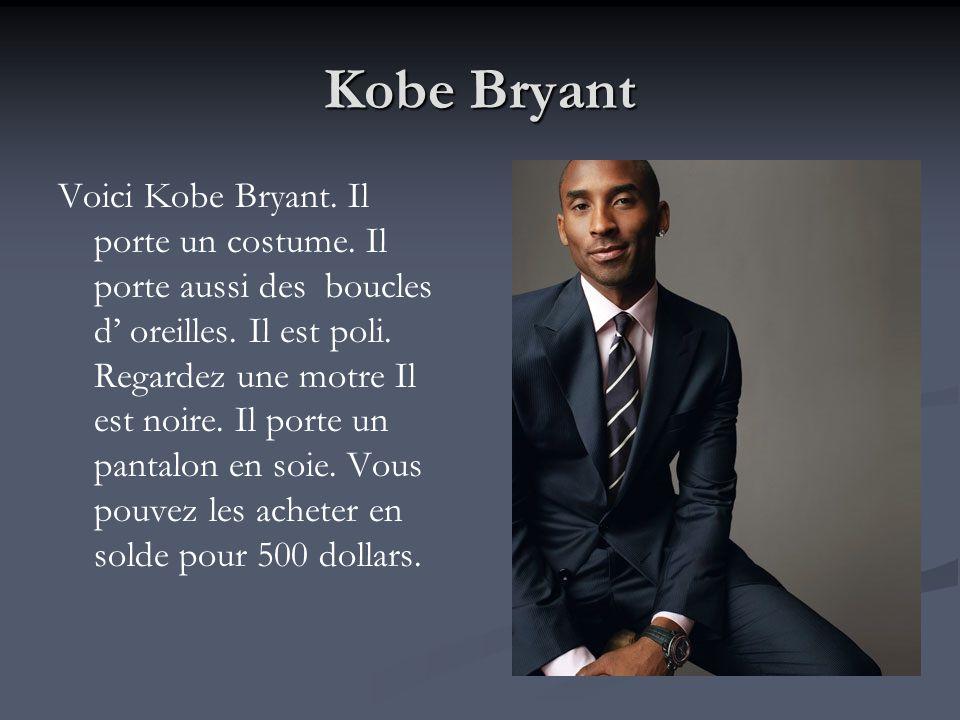 Kobe Bryant Voici Kobe Bryant. Il porte un costume. Il porte aussi des boucles d oreilles. Il est poli. Regardez une motre Il est noire. Il porte un p