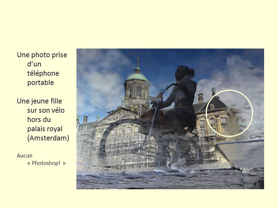 Une photo prise dun téléphone portable Une jeune fille sur son vélo hors du palais royal (Amsterdam) Aucun « Photoshop.
