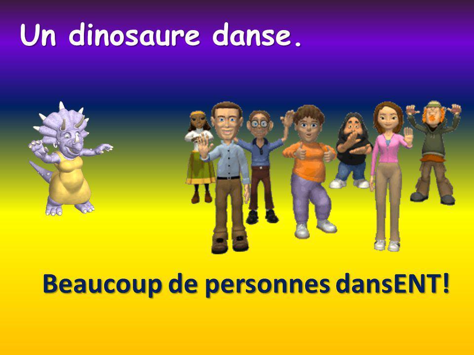Beaucoup de personnes dansENT! Un dinosaure danse.