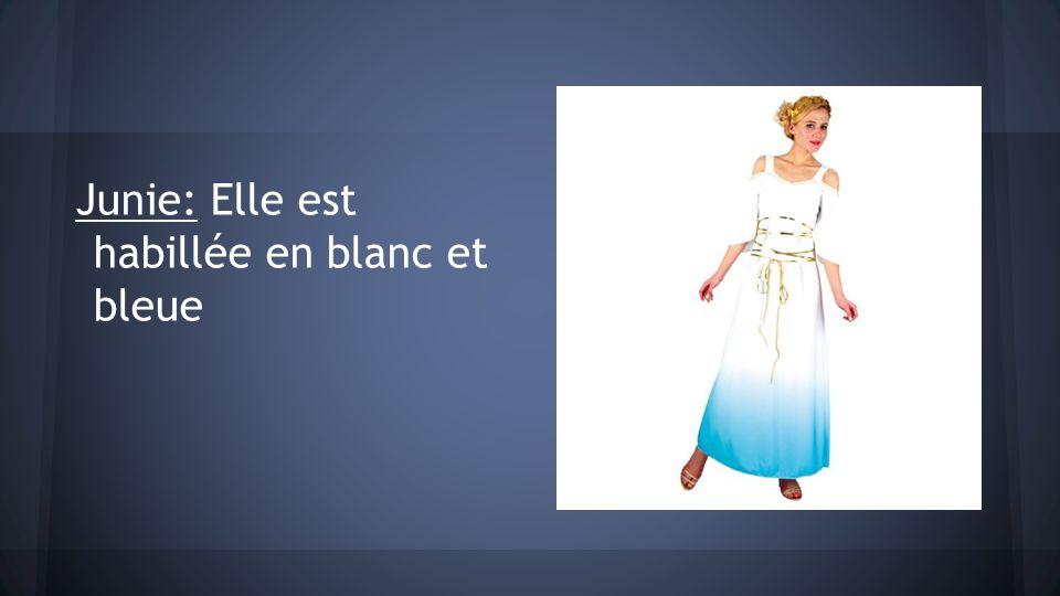 Junie: Elle est habillée en blanc et bleue